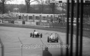 F1 cars rounding Woodcote