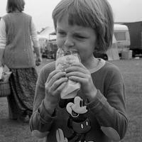 Simon eating a hot dog