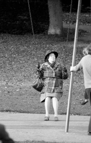Lady of a certain age on a swing