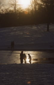 Setting sun over the frozen lake