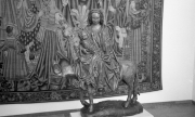 Statue and tapestry, unknown museum