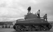 John Examining A Tank