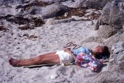 Sarah asleep on the beach