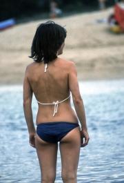 Girl in navy bikini