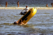 Fat frenchman falling out of dingy