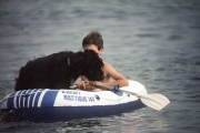 Large dog in small dingy