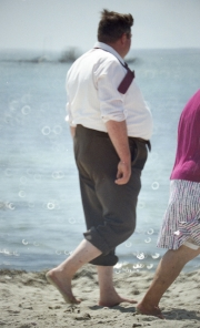 Fat Frenchman on the beach in shirt and tie