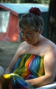 Greta reading, in her rainbow dress