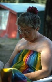 Greta reading, in her rainbow dress