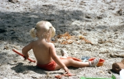 Small blonde girl on the beach