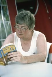 Greta reading in the tent