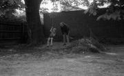 David on the garden swing, with John