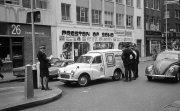 Olivetti van, with several police and traffic wardens