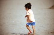 Small boy running on the beach