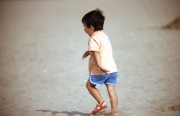 Small boy running on the beach