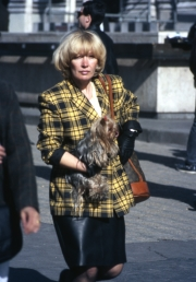 Lady carrying Yorkshire Terrier