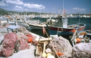 Fishing boat and nets in the harbour
