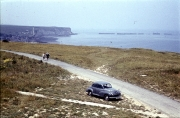 Mulberry Harbour and cliffs at Arromanches, with Bill's car