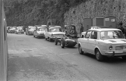 Line of parked cars, including a Formula Junior