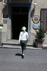 Greta entering the hotel