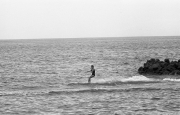 Lady in black swimsuit water-skiing